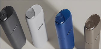 White, black, blue and gold IQOS 3 MULTI holders next to each other